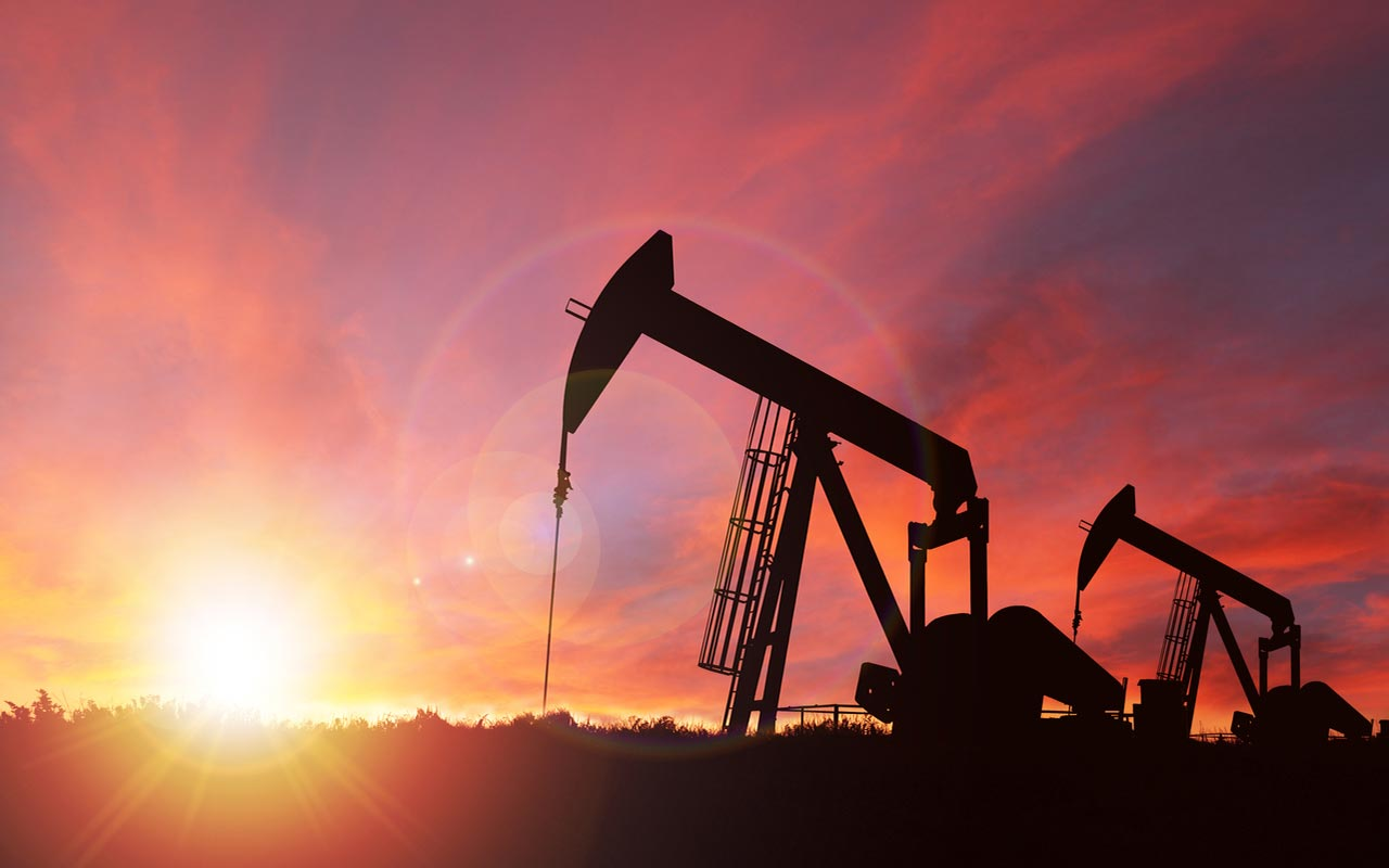 oil field silhouette at sunset